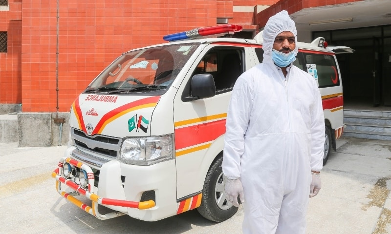 Ambulance driver Imran Khan dressed in protective gear before beginning his shift. — Photo courtesy Fazal Khaliq
