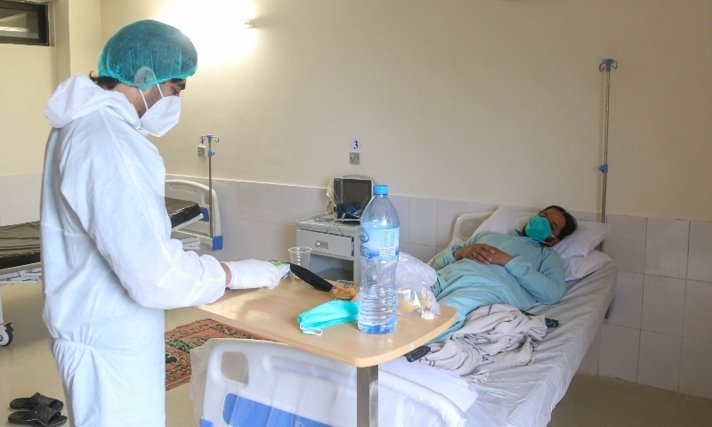 Dr Muhammad Arif checks the chart of a Covid-19 patient while on duty. — Photo courtesy Fazal Khaliq