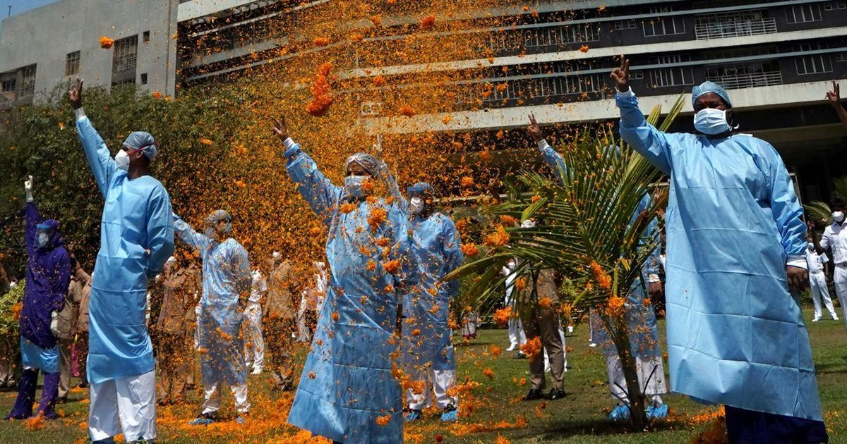 The staff of INHS Asvini hospital are showered with flower petals by an Indian Navy helicopter as part of an event to show gratitude towards the frontline staff fighting the coronavirus disease in Mumbai on March 3. — Reuters