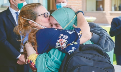 Freed Italian aid worker returns home on special flight