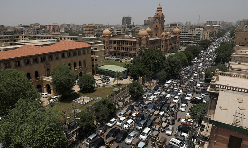 A general view of road traffic and the Karachi Metropolitan Corporation (KMC) building in the background in Karachi, May 11. — Reuters