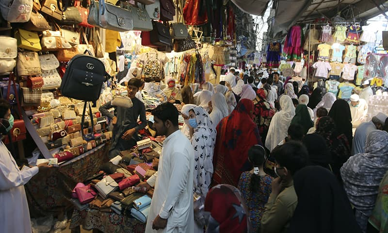 People shop in a market after the government relaxed the weeks-long lockdown that was enforced to curb the spread of the new coronavirus, in Peshawar on Monday, May 11. — AP