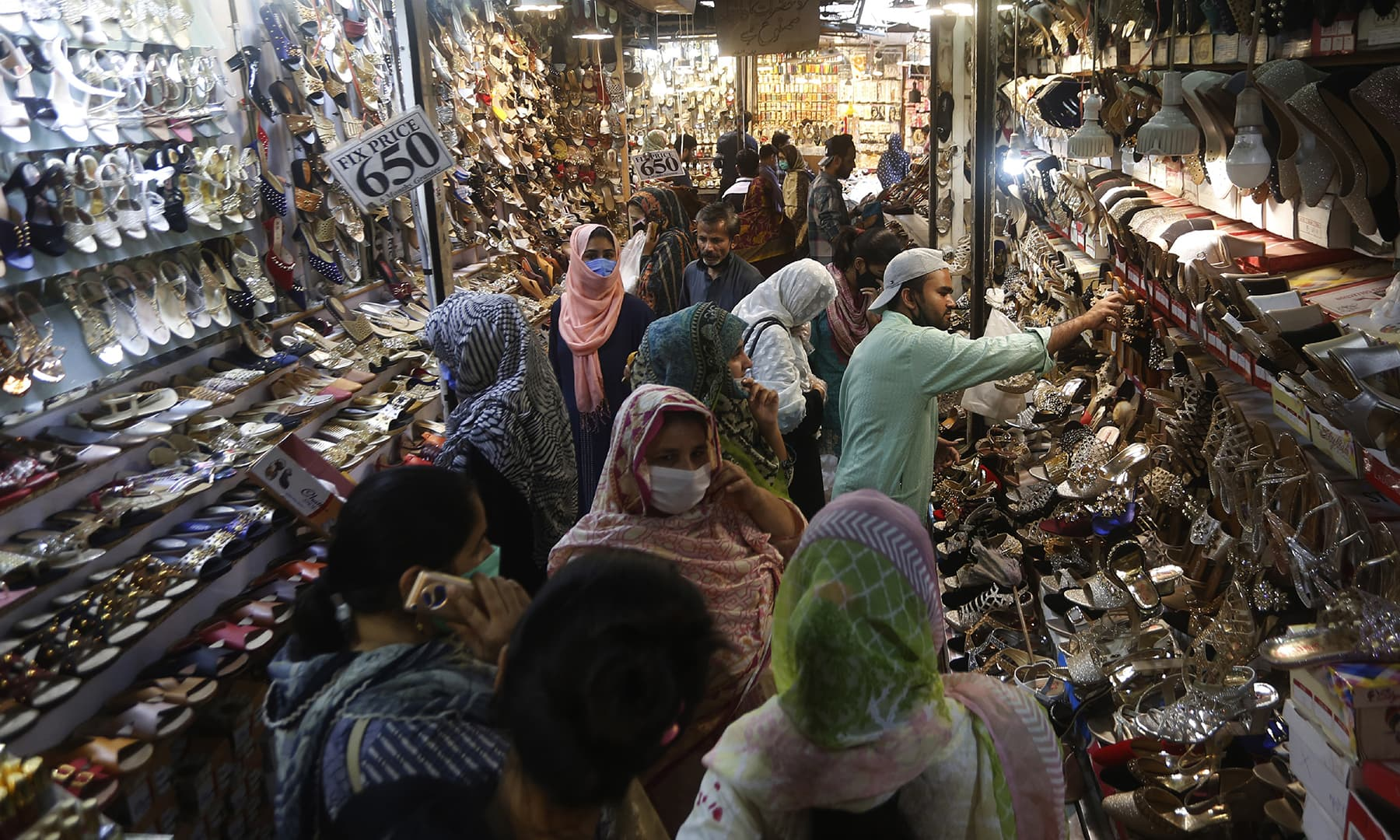 People visit a market after the government relaxed the weeks-long lockdown in Lahore. — AP