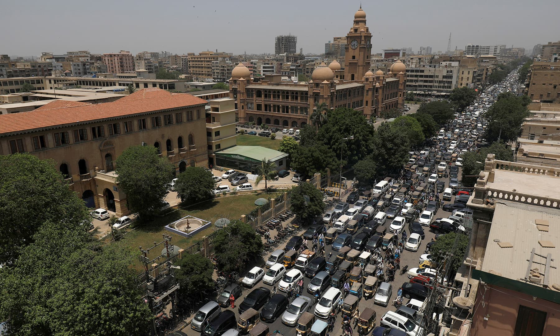 A general view of road traffic and the Karachi Metropolitan Corporation (KMC) building in the background in Karachi on Monday. — Reuters