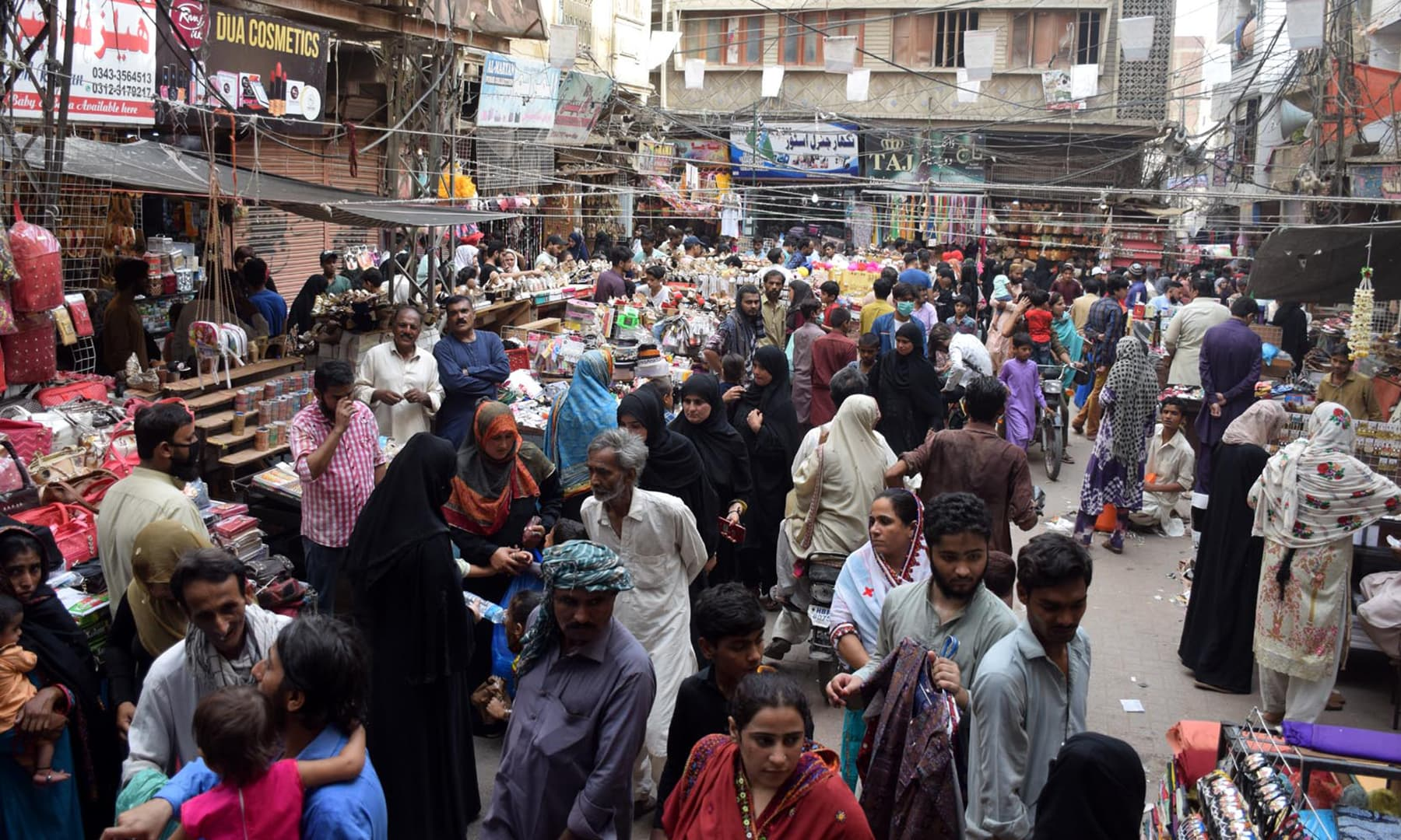 Shoppers throng a market in Hyderabad on the first day of the easing of the lockdown. — Photo by Umair Ali