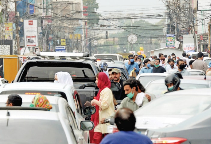 Traffic jam seen on Bank Road in Rawalpindi's Saddar area after the market reopened on Monday. — Photo by Mohammad Asim