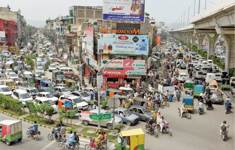 View of traffic on Murree Road in Rawalpindi on Tuesday, the second day since the lockdown was lifted. - Photo by Tanveer Shahzad