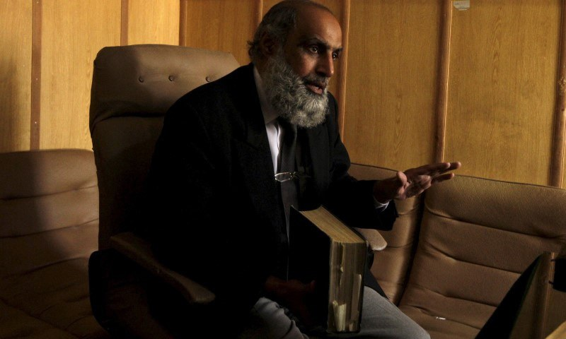 Former military judge Inam ul-Rahiem gestures during an interview with Reuters in Rawalpindi January 24, 2015. Rahiem is now a defence lawyer in high-profile military cases. REUTERS/Faisal Mahmood