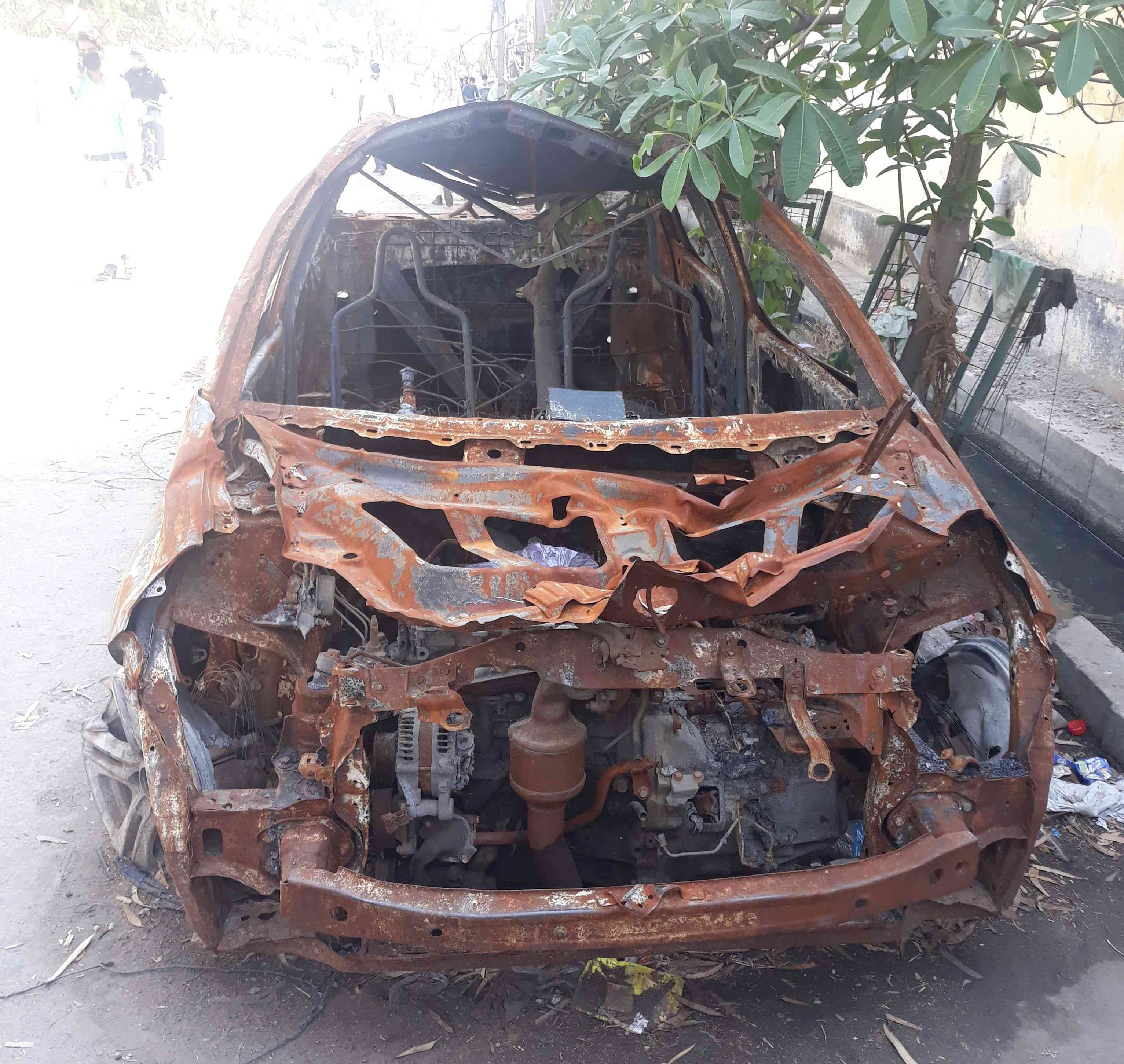 A burnt car in Mustafabad. — Photo by writer