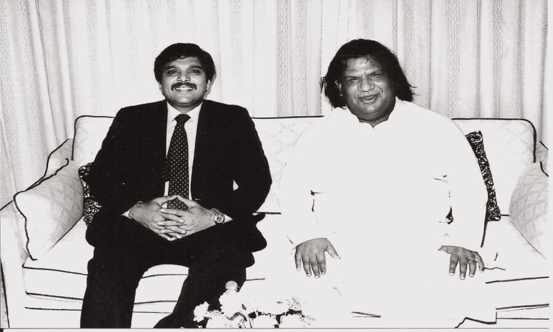 "Qawwali singer Aziz Mian with Ijazul Haq, son of Gen Ziaul Haq, sometime in the 1980s. Paracha writes in his book that ""Young, aspiring qawwals such as Aziz Mian often bounced between performing Punjabi qawwalis at the popular shrine of sufi saint Data Ganj Bakhsh in Lahore, and at private gatherings hosted by military officers, businessmen, bureaucrats and industrialists, where he performed Urdu qawwalis 