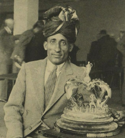 Sultan Khan with his trophy after winning the British Chess Championship (1932)