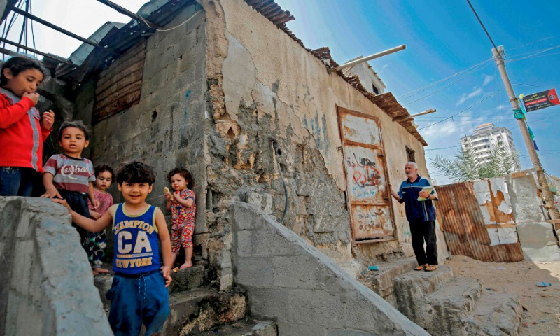 Palestinian children are pictured outside their shacks in Gaza City's Al-Shati refugee camp on May 15 as Palestinians marked the 72nd anniversary of Nakba (Day of Catastrophe). — AFP