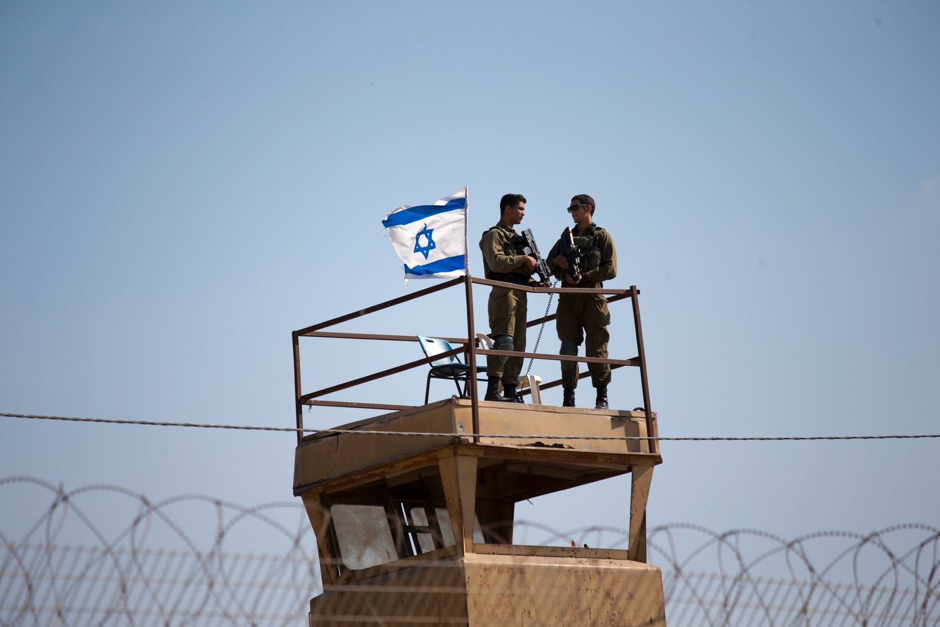 Israeli soldiers guard on top of a watch tower in a community along the Israel-Gaza border strip. — AP