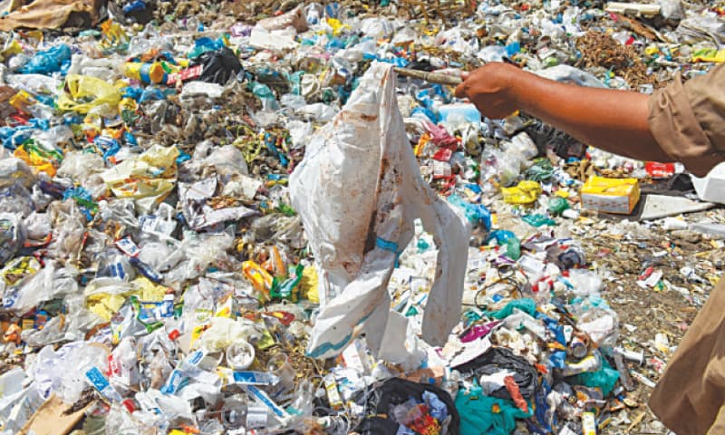 A discarded body suit, part of personal protective equipment, lies in a garbage dump near Abbasi Shaheed Hospital.—Fahim Siddiqi/White Star