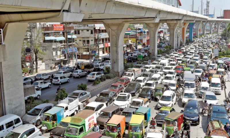 Murree Road is choked with traffic on Monday after a lockdown of three days. — Photo by Tanveer Shahzad