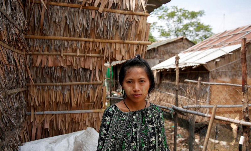 Zarchi Liwn poses for photo near her hostel, in an industrial zone on the outskirts of Yangon, Myanmar, April 28. — Reuters