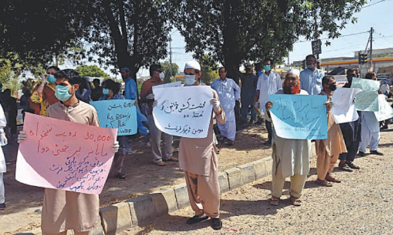 CARRYING placards inscribed with their demands, a group of workers hold a protest demonstration in the SITE area on Tuesday.—White Star