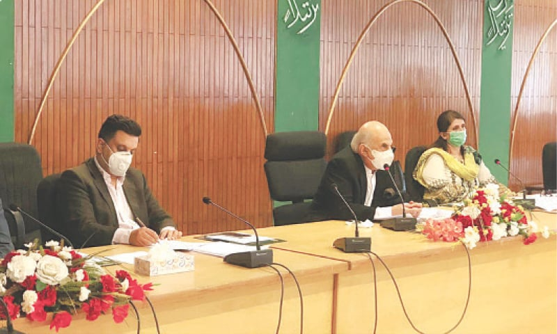 ISLAMABAD: Planning Commission Deputy Chairman Jehanzeb Khan chairs a session of the CDWP on Tuesday.