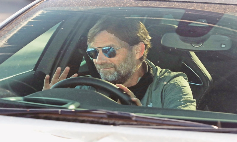 LIVERPOOL manager Jurgen Klopp arrives at the club's Melwood training ground on Wednesday.—AP