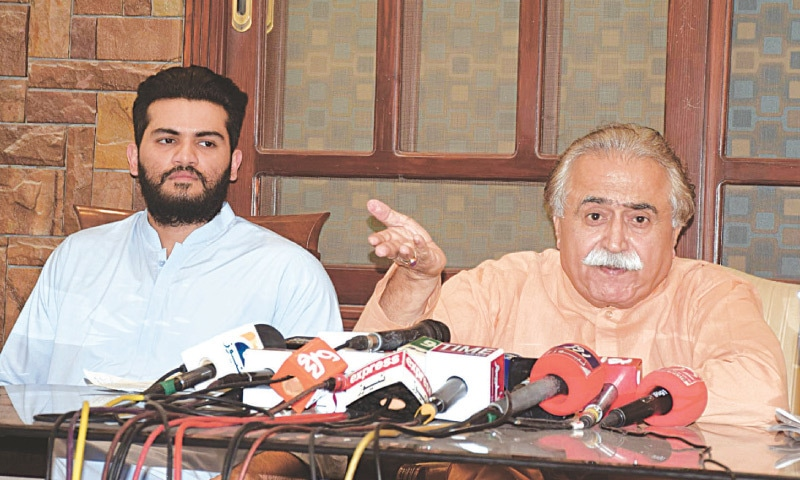 PPP information secretary Moula Bux Chandio speaks at the press conference at his residence in Hyderabad on Thursday.—Dawn