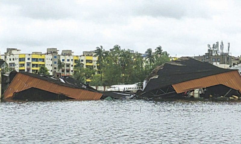 KOLKATA: An aircraft is parked behind a collapsed hangar at the flooded Netaji Subhas Chandra Bose International Airport on Thursday—AFP