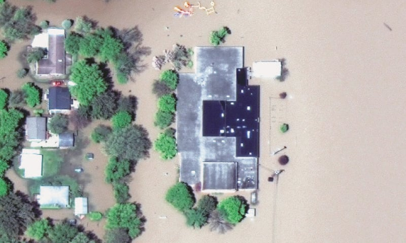 MIDLAND (Michigan, US): A satellite image shows a flooded high school.—Reuters