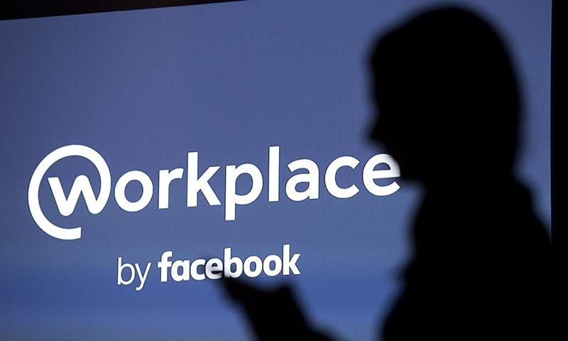 "Facebook's Workplace is adding virtual ""rooms"" where as many as 50 people can drop in for video chats. — AFP/File"