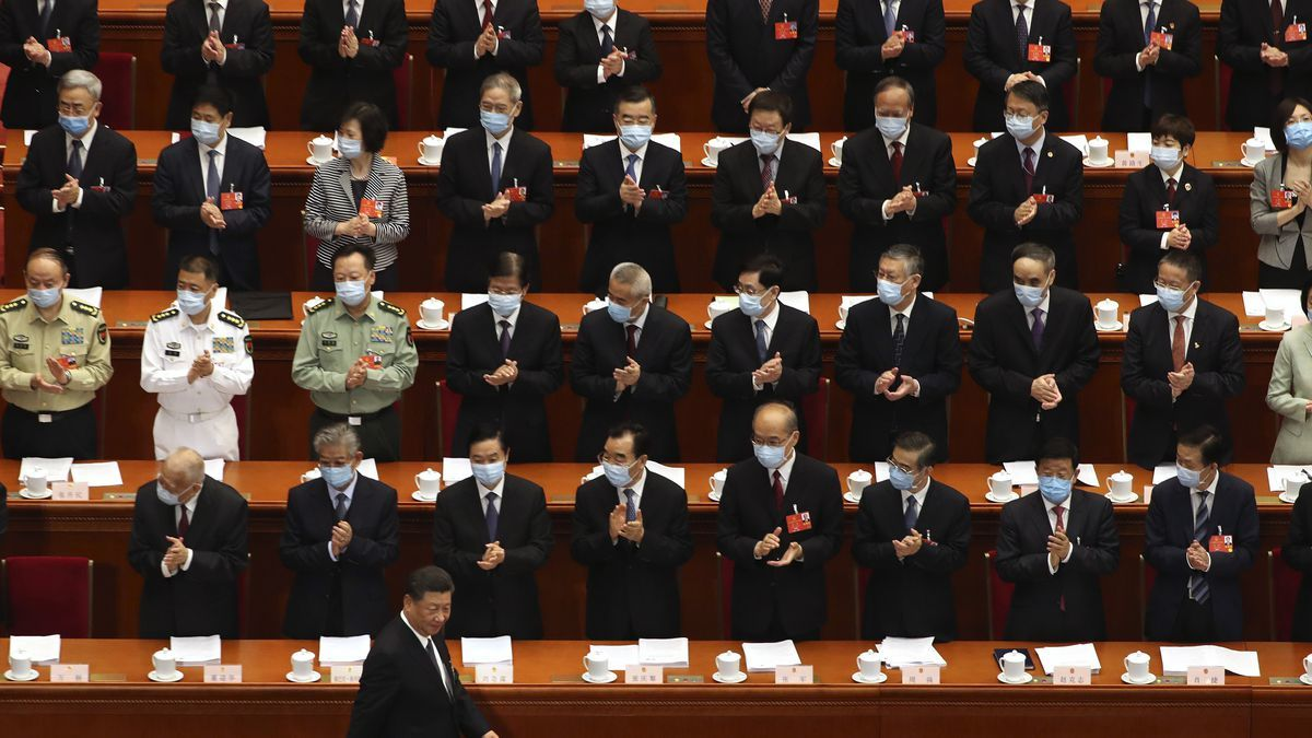Delegates applaud as Chinese President Xi Jinping arrives for the opening session of China's National People's Congress (NPC) at the Great Hall of the People in Beijing on Friday. — AP