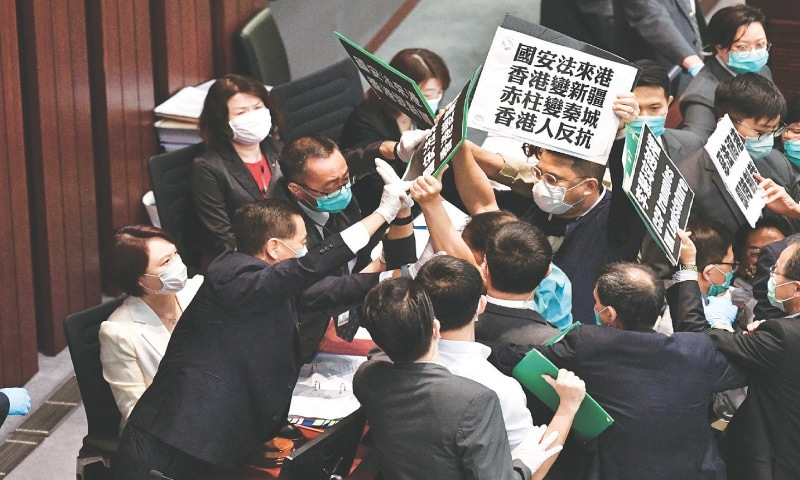 Hong Kong: Security personnel block pro-democracy lawmakers from holding a rally during a meeting of a legislative committee on Friday.—AFP