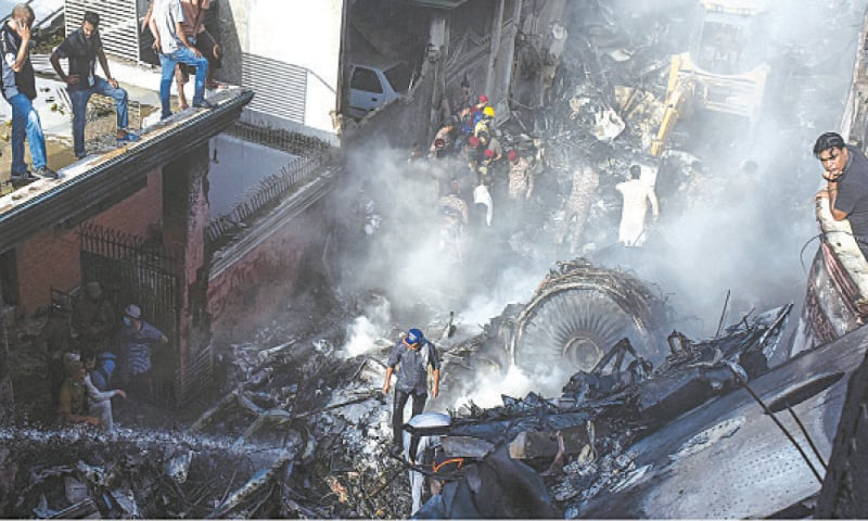Clockwise: Firefighters busy dousing flames at the plane crash site at Model Colony near the airport on Friday. Rescue workers search the debris for survivors. This video grab shows Bank of Punjab president Zafar Masud, who was on board the aircraft, being rescued. Rangers personnel taking two children from the accident site.—Fahim Siddiqi-White Star / APP