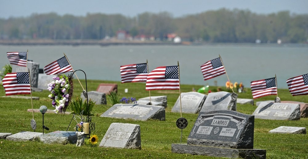 American flags fly over the graves of veterans on May 19, a few days before Memorial Day, at Lakeside Cemetery in Erie, Pennsylvania. — AP