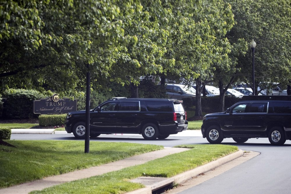 The motorcade for US President Donald Trump arrives at Trump National Golf Club, May 23, in Sterling, Virginia, US. — AP
