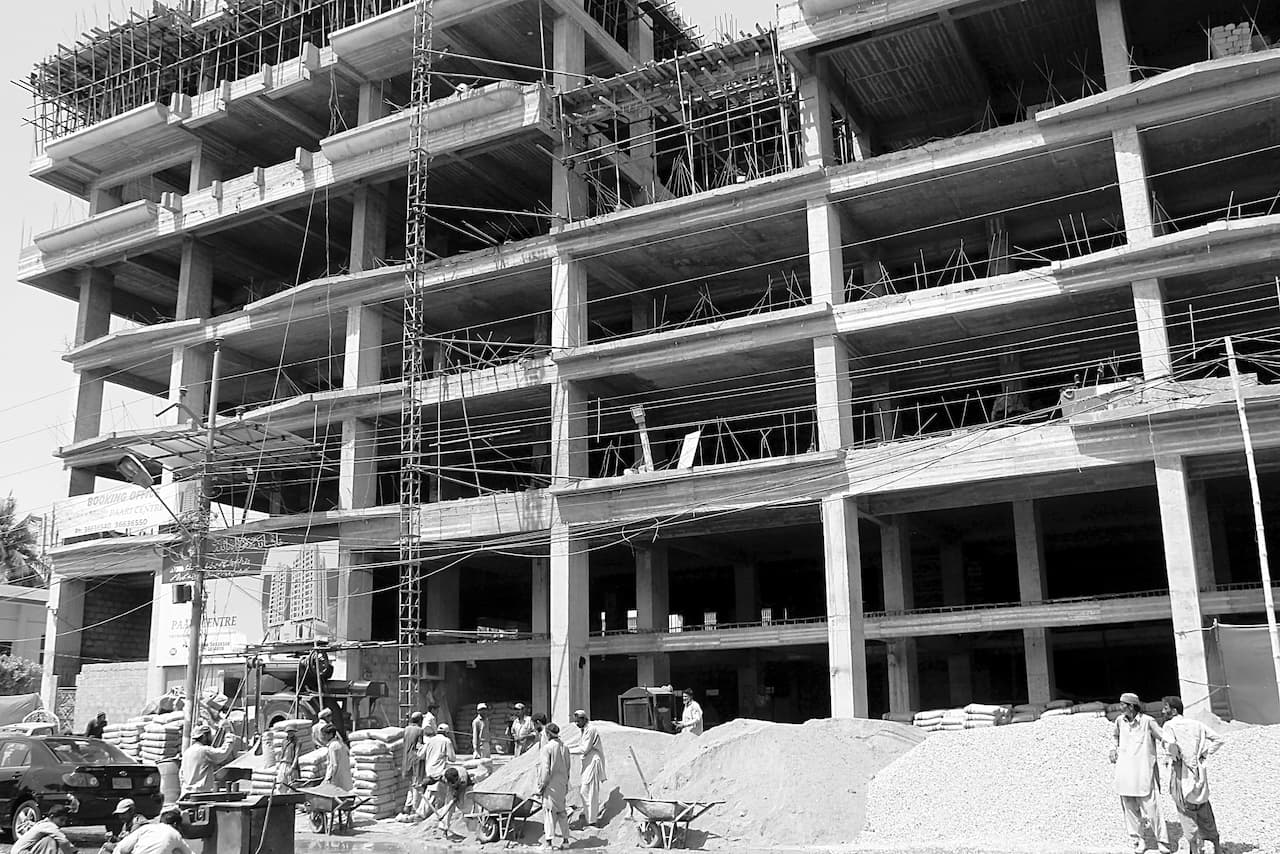 Labourers working on an under-construction residential project in Karachi   Fahim Siddiqi/White Star