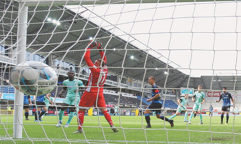 PADERBORN: SC Paderborn goalkeeper Leopold Zingerle (2ndL) concedes a goal against TSG Hoffenheim during the German first division Bundesliga match on Saturday.—AFP