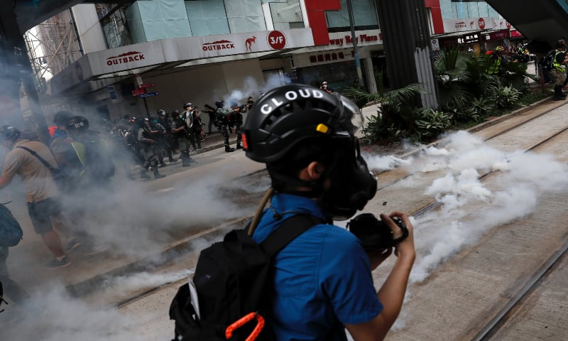 Hong Kong police fire tear gas on biggest protests since virus curbs