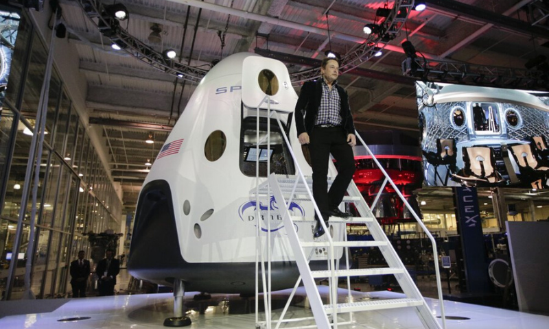 In this Thursday, May 29, 2014 file photo, Elon Musk, CEO and CTO of SpaceX, walks down the steps during the introduction of the SpaceX Dragon V2 spaceship at the headquarters in Hawthorne, California. — AP
