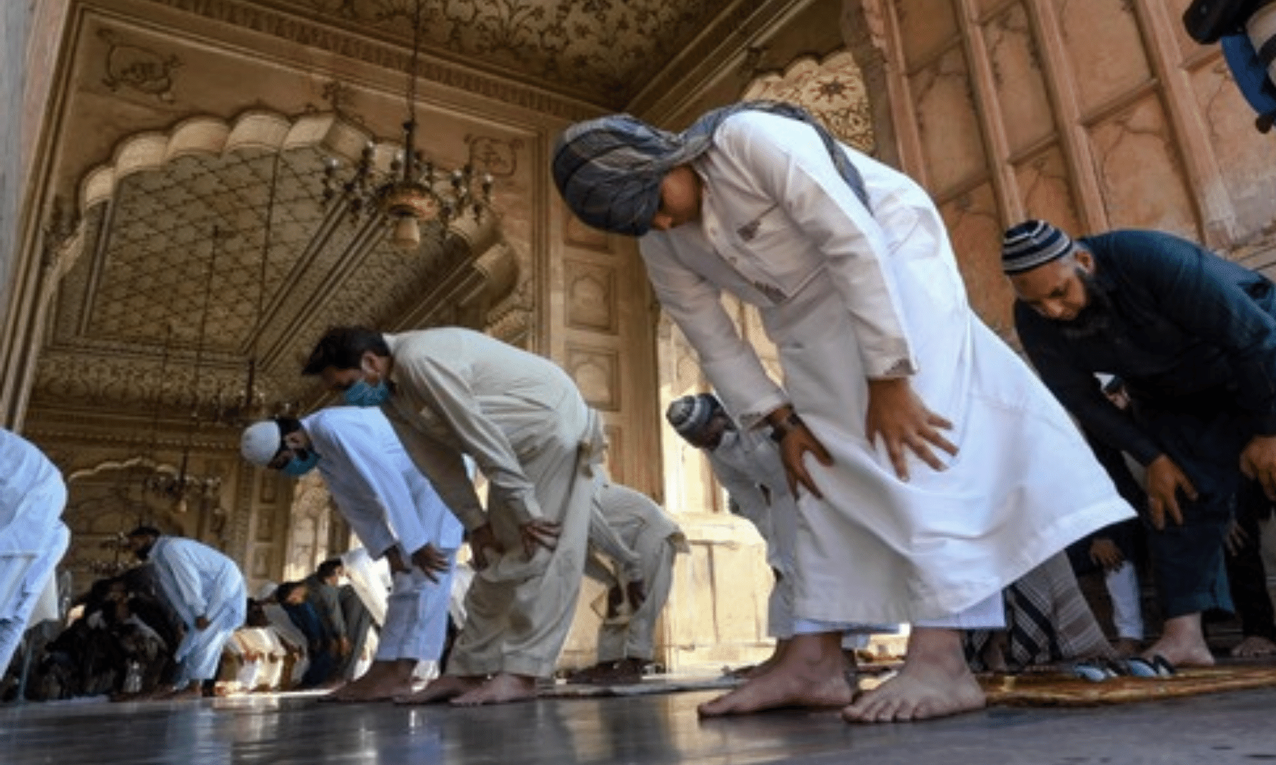 Muslims offer Eidul Fitr prayers at the Badshahi Mosque. — AFP