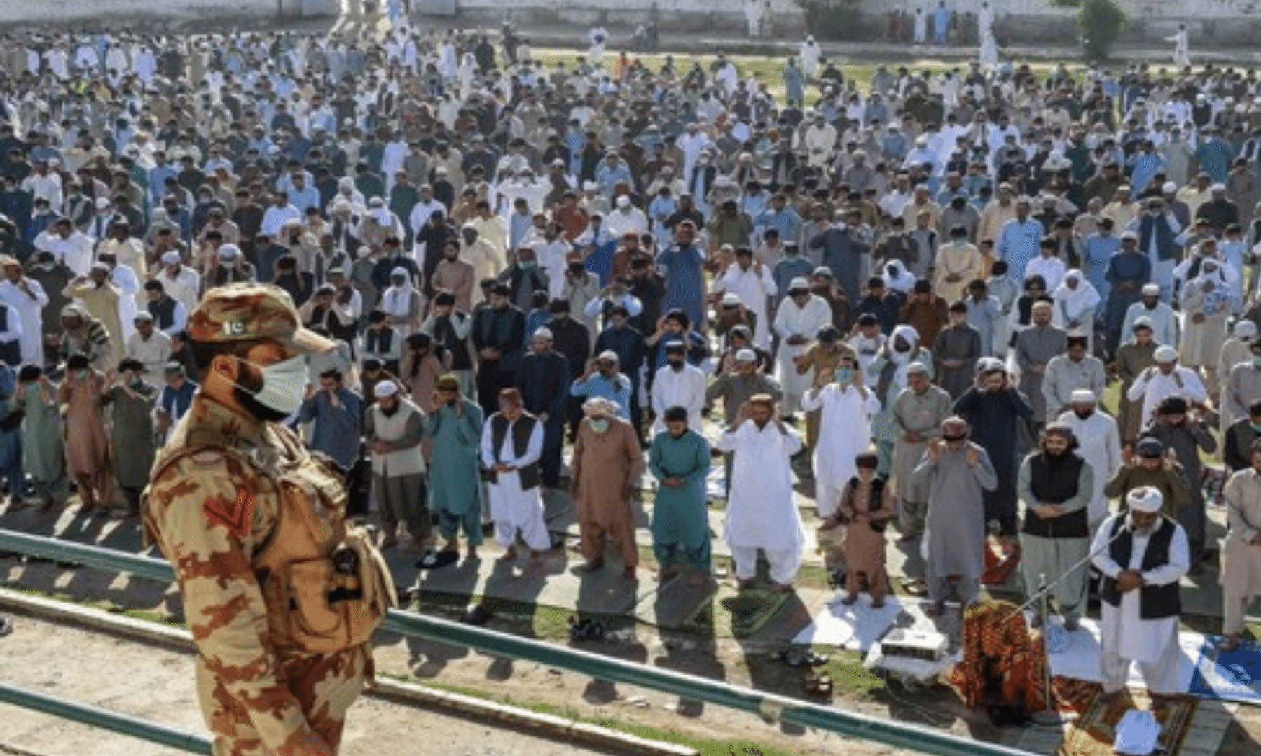 A Frontier Corps personnel stands guard as worshippers offer Eid prayers at a ground in Quetta. — AFP