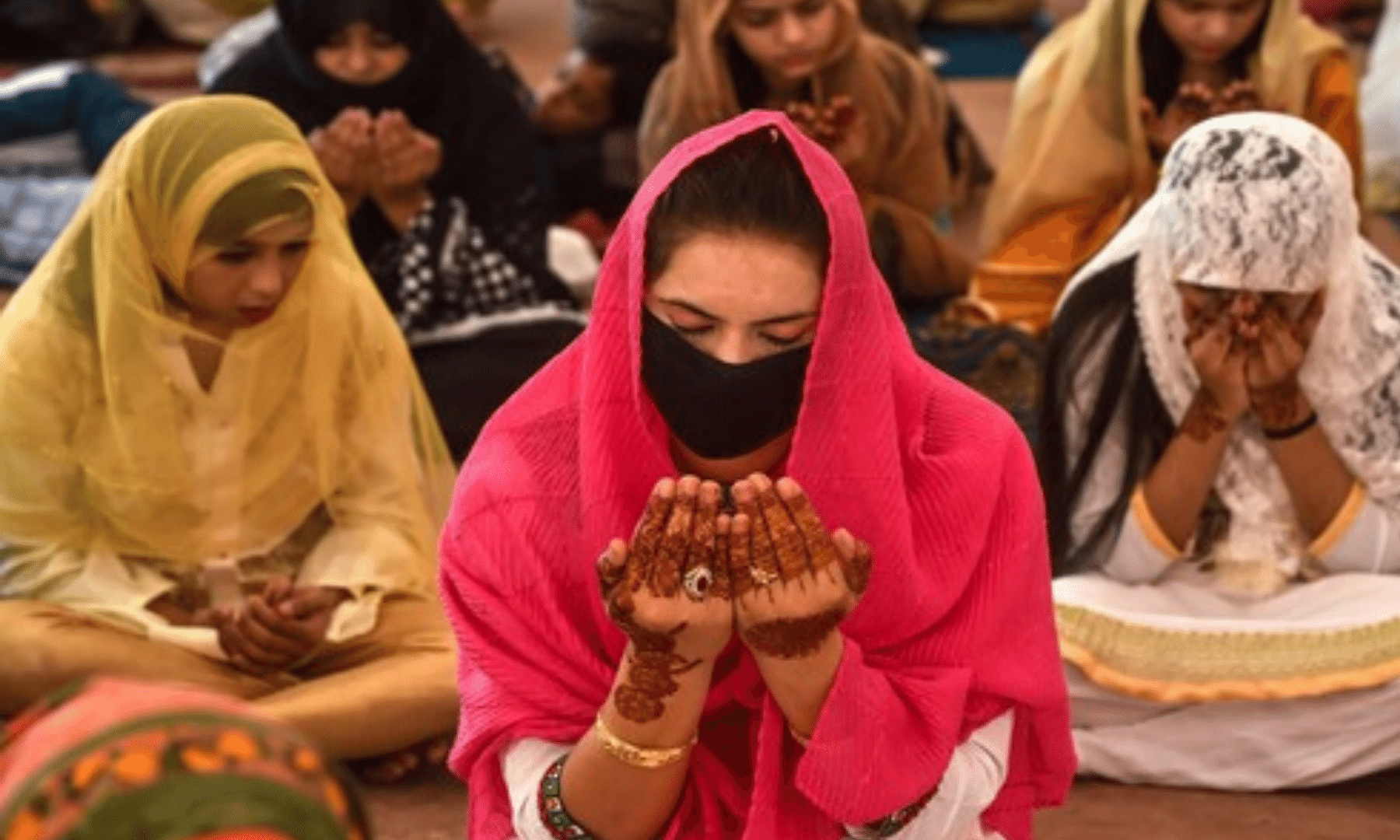 A woman offers the Eidul Fitr prayer while wearing a mask. The federal government has made it compulsory to wear masks in public in abid to curb the spread of coronavirus. — AFP
