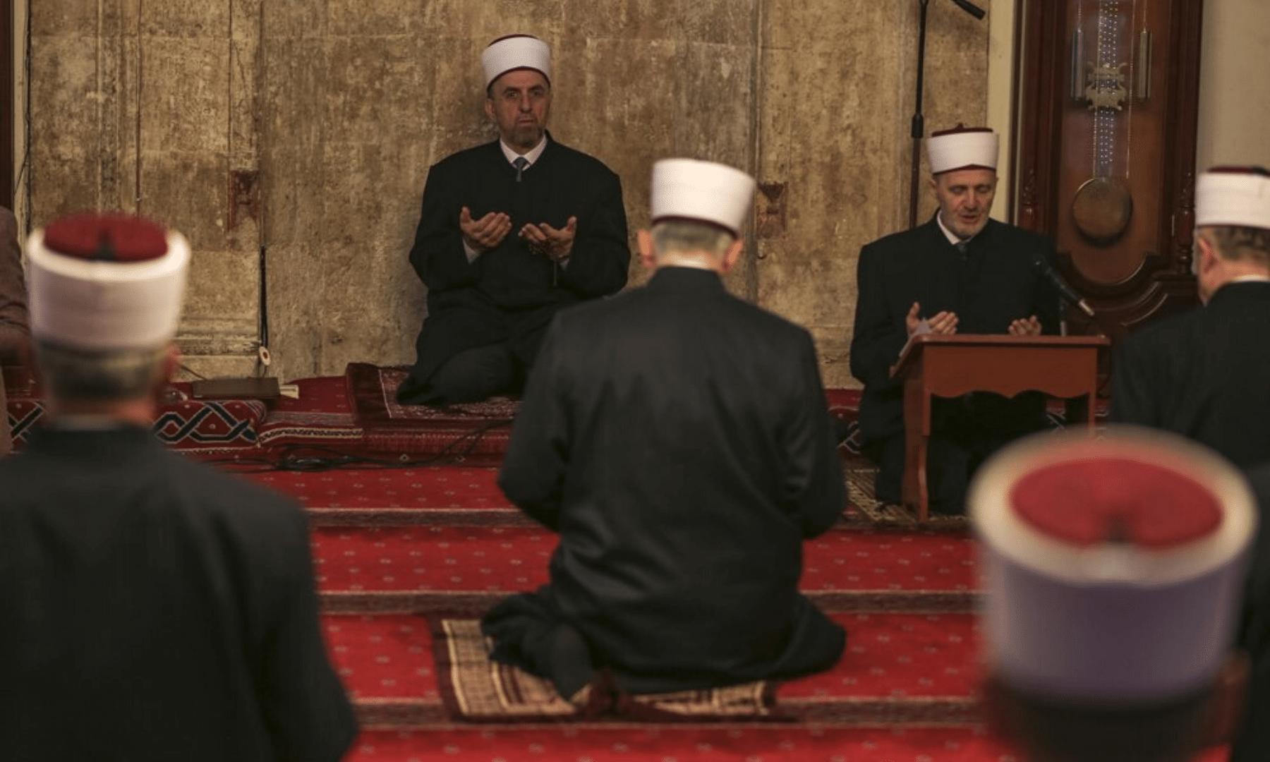 Kosovo's grand mufti Naim Ternava, left rear, leads the Eidul Fitr prayer at the grand mosque in Pristina, Kosovo. Kosovo's mosques have been closed since March 14 because of the spread of Covid-19. — AP