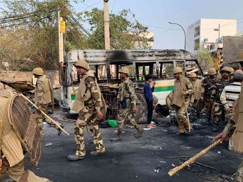 A photo of police patrolling Gonda Chowk in North East Delhi during the violence. — Scroll staff