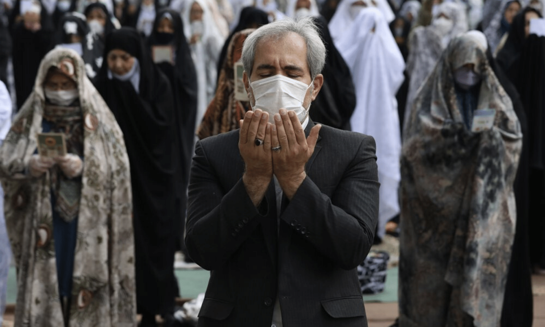 Worshippers wearing protective face masks offer Eidul Fitr prayers outside a mosque to help prevent the spread of the coronavirus, in Tehran, Iran. Authorities have imposed few restrictions ahead of the holiday aside from cancelling mass prayers in the capital. — AP