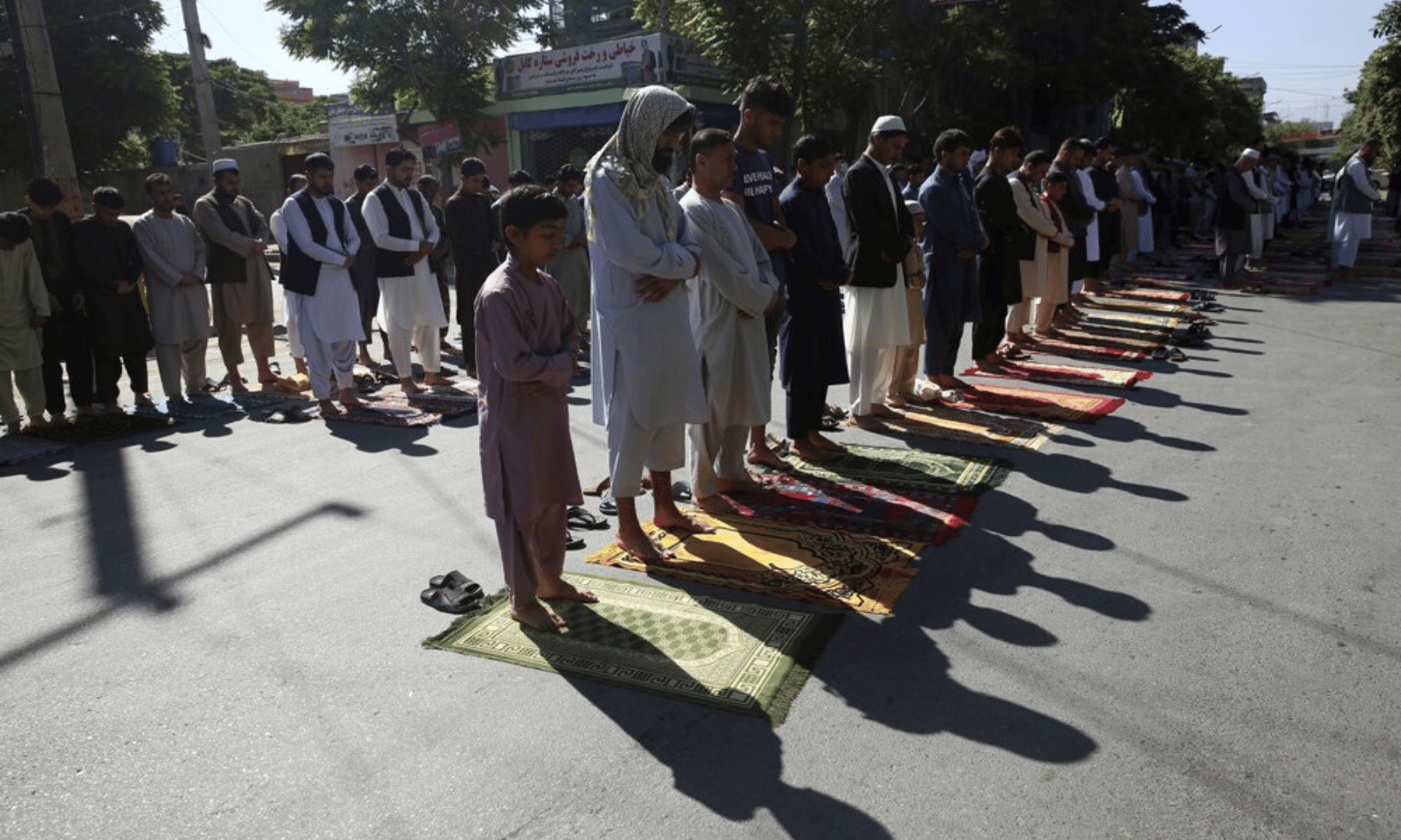 Men attend the Eidul Fitr prayers outside a mosque in Kabul, Afghanistan. The country has seen a spike in violence in recent weeks but a three-day ceasefire has been announced for Eid. — AP