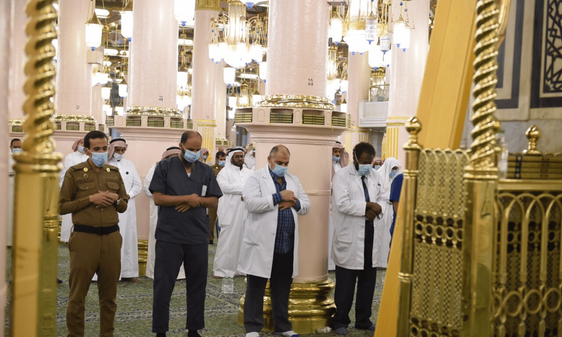 Doctors and policemen offer the Eidul Fitr prayers at the Prophet's Mosque in Madinah. — Saudi Press Agency