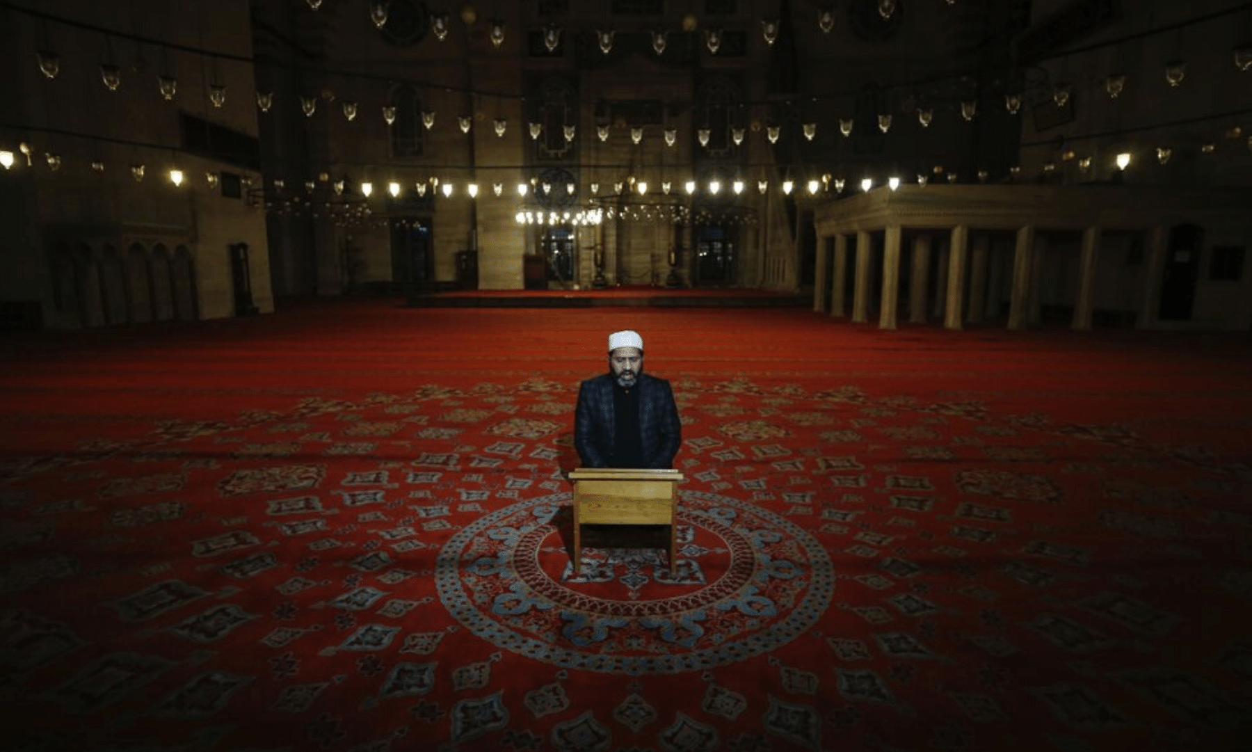 An imam recites verses of the Quran during the Eidul Fitr prayer amid concerns of the coronavirus outbreak at the historical Suleymaniye Mosque in Istanbul, Turkey. — AP