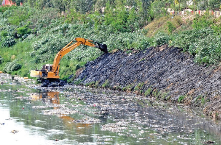 Dredging is carried out every year in Leh Nullah ahead of monsoon to remove mud and any other obstacles so that rainwater can flow smoothly. — File photo
