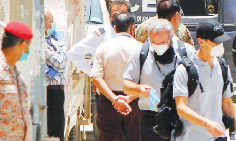 KARACHI: A team of Airbus experts arrives at the crash site to inspect it.—PPI