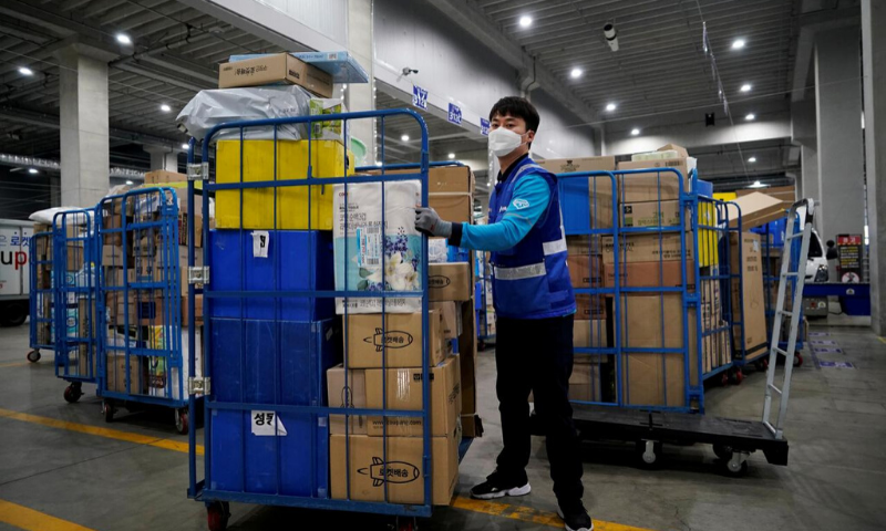 File picture of a delivery man for Coupang wearing a mask to prevent contracting the coronavirus, loading packages before leaving to deliver them in Incheon, South Korea. — Reuters
