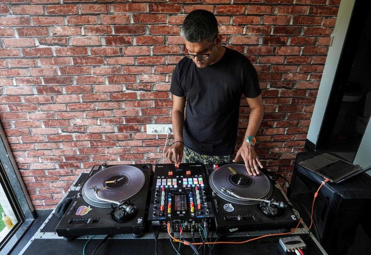 Sanjay Meriya plays music inside his home after returning from a temporary health centre where he coaches slum dwellers on the precautions they should take to avoid being infected with Covid-19, in Mumbai, India, May 25. — Reuters