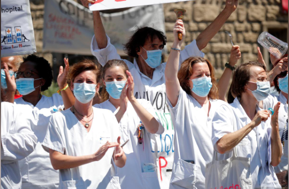 French health workers attend a demonstration in Paris. — Reuters